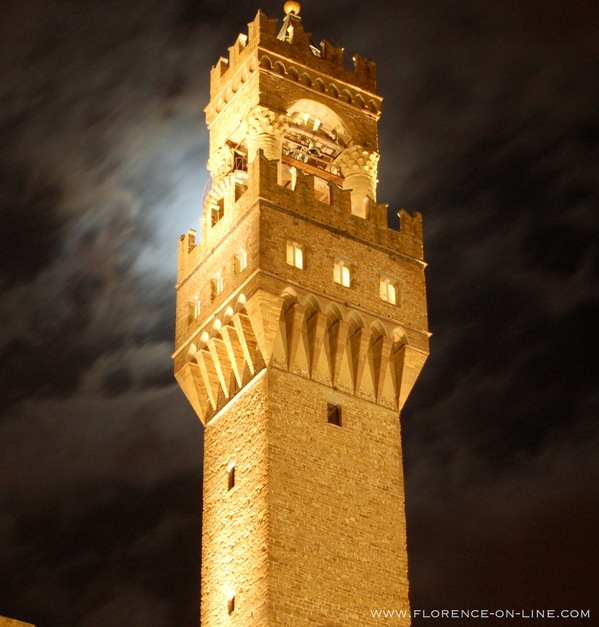 Arnolfo di Cambio's Tower of Palazzo Vecchio with a full moon behind it